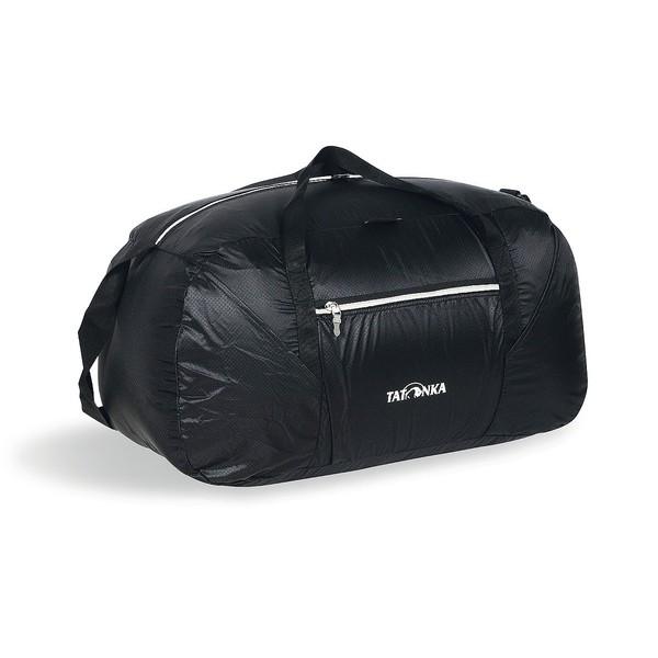 Сумка Tatonka Squeezy Duffle M blackЛегкая и вместительная дорожная сумка Tatonka Squeezy Duffle M пригодится в любом путешествии. Сумка сделана из материала T-Rip Light с силиконовым покрытием. В свернутом виде сумка легко убирается в интегрированный карман на молнии. Такую сумку можно брать с собой повсюду, не боясь, что она займет много места.<br><br>Вес кг: 0.30000000