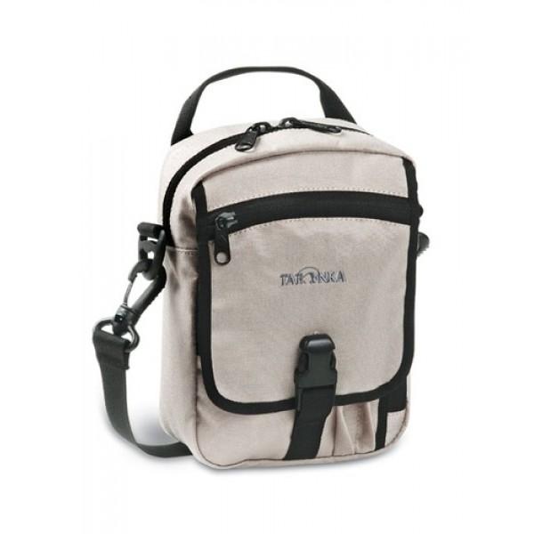 Сумка Tatonka Check in Special beige, 2842.019Идеальная сумочка для хранения документов и полезных мелочей в путешествии. Сумочка Check In , которую можно носить как на плече, так и на поясе, располагает большим основным отделением с двумя молниями , множеством кармашков и мини-органайзером. Крышка-клапан фиксируется фастексом.<br><br><br>петли для переноски на поясе<br><br>съемный плечевой ремень<br><br>ручка для переноски<br><br>прочный материал 450 HD Polyoxford<br><br>Вес кг: 0.24000000