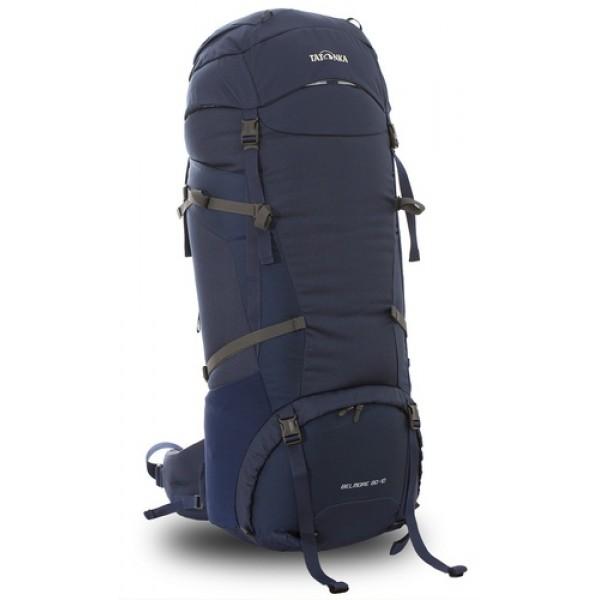 Рюкзак Tatonka Belmore 80+10 navyРюкзак Belmore 80+10 выполенен в строгом дизайне из прочной ткани Textreme 6.6. Одно просторное отделение позволит с удобством разместить все необходимые в походе или путешествии вещи. Засчет объемной крышки и расширяющегося основного отделения объем рюкзака достигает 90 литров. Прочная удобная спина рюкзака выполнена с учетом анатомических особенностей спины человека, благодаря этому с рюкзаком будет комфортно идти даже в продолжительном походе. Нижнее и основное отделения рюкзака разделены съемной перегородкой на молнии, одним движением их можно соединить между собой или снова разделить. Доступ в основное отделение осуществляется через верхний расширяющийся вход, в нижнее отделение оснащено молнией с двумя бегунками, благодаря чему можно получить доступ к конкретным нужным вещам, не открывая молнию полностью.<br><br><br>Система подвески Y1<br><br>Одно основное отделение, уведичивающееся в объеме в верхней части<br><br>Объемная крышка рюкзака с крючком для ключей<br><br>4 петли на крышке<br><br>Крышка рюкзака регулируется по высоте (до 25 см выше стандартного положения)<br><br>Затяжка внутреннего отделения на один или два шнура, в зависимости от объема заполнения<br><br>4 боковые затяжки позволяют регулировать объем<br><br>Петли для крепления треккинговых палок<br><br>Два боковых просторных кармана<br><br>Широкий плотный набедренный пояс с двумя параметрами регулировки (по ширине и степени прилегания к рюкзаку)<br><br>Регулировка спины рюкзака позволяет отрегулировать высоту лямок, натяжение лямок относительно спины рюкзака<br><br>Спина рюкзака выполнена с учетом анатомических особенностей спины человека<br><br>Сетчатые элементы в спине и набедренном поясе позволяют обеспечить вентиляцицю в жаркую погоду<br><br>Регулируемый по ширине и высоте нагрудный ремень<br><br>В нагрудный ремень вшита резинка для комфорта движения<br><br>Прочная ручка для переноски и помощи при надевании рюкзака<br><br>Молния в нижнее отделение оснащена двумя 