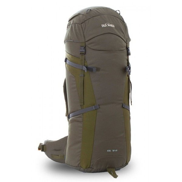 Рюкзак Tatonka Eol 70+10 oliveУниверсальный рюкзак Eol 70+10 выполенен в строгом дизайне из прочной ткани Textreme 6.6. Одно просторное отделение позволит с удобством разместить все необходимые в походе или путешествии вещи. Засчет объемной крышки и расширяющегося основного отделения объем рюкзака достигает 80 литров. Прочная удобная спина рюкзака выполнена с учетом анатомических особенностей спины человека, благодаря этому с рюкзаком будет комфортно идти даже в продолжительном походе.<br><br><br>Система подвески Y1<br><br>Одно основное отделение, увеличивающееся в верхней части<br><br>Объемная крышка рюкзака с крючком для ключей<br><br>4 петли на крышке<br><br>Крышка рюкзака регулируется по высоте (до 25 см выше стандартного положения)<br><br>Затяжка внутреннего отделения на один или два шнура, в зависимости от объема заполнения<br><br>4 боковые затяжки позволяют регулировать объем<br><br>Петли для крепления треккинговых палок<br><br>Два боковых просторных кармана<br><br>Широкий плотный набедренный пояс с двумя параметрами регулировки (по ширине и степени прилегания к рюкзаку)<br><br>Регулировка спины рюкзака позволяет отрегулировать высоту лямок, натяжение лямок относительно спины рюкзака<br><br>Спина рюкзака выполнена с учетом анатомических особенностей спины человека<br><br>Сетчатые элементы в спине и набедренном поясе позволяют обеспечить вентиляцицю в жаркую погоду<br><br>Регулируемый по ширине и высоте нагрудный ремень<br><br>В нагрудный ремень вшита резинка для комфорта движения<br><br>Прочная ручка для переноски и помощи при надевании рюкзака<br><br>Вес кг: 2.35000000