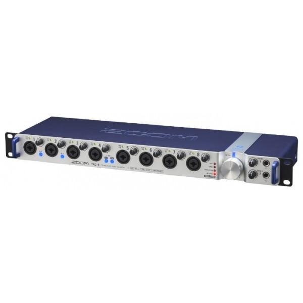 Аудиоинтерфейс ZOOM TAC-8Цифровой аудиоинтерфейс Zoom TAC-8 специально разработан для того, чтобы выступать главным концентратором в профессиональных и домашних условиях. Его потенциальные возможности поражают даже на первый взгляд: 8 аналоговых входов, 10 аналоговых выходов и по 10 цифровых входов и выходов (как в формате S/PDIF, так и в ADAT Optical), плюс вход и выход MIDI и поддержка Word Clock.<br><br>TAC-8 позволит вам воспользоваться всеми преимуществами современных технологий, как при мультиканальной записи длительных сессий в качестве 24-бит/192k без каких-либо задержек, так и при живом выступлении на сцене.<br><br>TAC-8 оснащен восемью аналоговыми входами в сочетании с дополнительными цифровыми возможностями, что позволит вам записывать что угодно и когда угодно. Записывайте бас, барабаны, гитару и вокал одновременно или же наоборот подключите восемь микрофонов к барабанной установки или выберите свой собственный вариант. Скорость интерфейса Thunderbolt обеспечит вам минимум задержек, а программный микшер и настройки выхода позволят вам подогнать все необходимые параметры под ваши требования.<br><br>TAC-8 позволит вам использовать ноутбук на сцене и обеспечит высокое качество звучания. Просто подключите TAC-8 к вашему компьютеру при помощи кабеля Thunderbolt, а затем соедините передний TRS-разъем с вашим микшерным пультом или радиосистемой. TAC-8 справится с задачей, как для одного музыканта со сложной системой музыкального оборудования, так и если он выступает центральным хабом в комплексе из различных инструментов для целой музыкальной группы.<br><br>TAC-8 предлагает вам широкий выбор как аналоговых, так и цифровых разъемов. Восемь совмещенных XLR/TRS-разъемов принимают микрофонный и линейный сигналы. Первые два входа также способны принимать инструментальный сигнал электрогитар и бас-гитар. ЖК-индикаторы и индивидуальные регуляторы усиления позволят вам с легкостью добиться оптимального уровня усиления. Поддержка фантомного питания с возможностью выбора