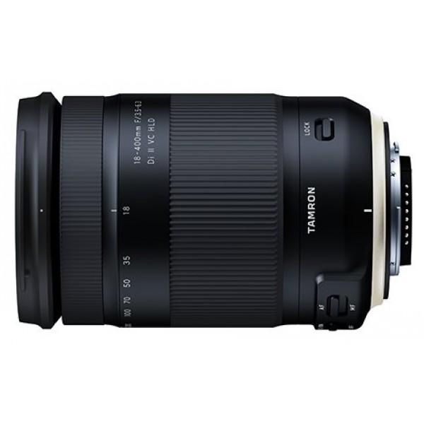 """Объектив Tamron 18-400mm f/3.5-6.3 Di II VC HLD (B028) Nikon FTamron 18-400mm f/3.5-6.3 Di II VC HLD (B028) Nikon F - это первый в мире объектив для зеркальных камер кроп-формата APS-C, который охватывает диапазон фокусных расстояний 18-400 мм и имеет коэффициент зуммирования 22,2x. Фокусное расстояние 400mm на длинном конце позволяет делать ультрателеснимки с 35-миллиметровым эквивалентом фокусного расстояния 620mm. Теперь фотографы смогут в полной мере насладиться эффектами ультра-телефото, визуально приближающими отдаленные предметы и значительно сглаживающими перспективу. Универсальный зум-объектив """"все-в-одном"""" идеально подходит как для путешествий, так и для повседневного ношения. Он позволяет фотографу переключаться с широкоугольного на ультрателедиапазон, не меняя объективов, чтобы быстрее и легче снимать гораздо более широкий круг объектов, включая сцены путешествий, дикую природу, спортивные состязания, пейзажи, городскую архитектуру, портреты и продукты питания.<br><br>Вес кг: 0.75000000"""