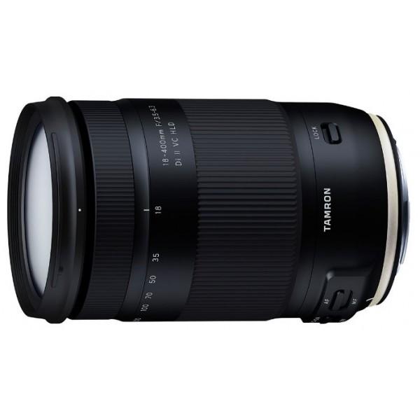 """Объектив Tamron 18-400mm f/3.5-6.3 Di II VC HLD (B028) Canon EF-STamron 18-400mm f/3.5-6.3 Di II VC HLD (B028) Canon EF-S - это первый в мире объектив для зеркальных камер кроп-формата APS-C, который охватывает диапазон фокусных расстояний 18-400 мм и имеет коэффициент зуммирования 22,2x. Фокусное расстояние 400mm на длинном конце позволяет делать ультрателеснимки с 35-миллиметровым эквивалентом фокусного расстояния 620mm. Теперь фотографы смогут в полной мере насладиться эффектами ультра-телефото, визуально приближающими отдаленные предметы и значительно сглаживающими перспективу. Универсальный зум-объектив """"все-в-одном"""" идеально подходит как для путешествий, так и для повседневного ношения. Он позволяет фотографу переключаться с широкоугольного на ультрателедиапазон, не меняя объективов, чтобы быстрее и легче снимать гораздо более широкий круг объектов, включая сцены путешествий, дикую природу, спортивные состязания, пейзажи, городскую архитектуру, портреты и продукты питания.<br><br>Вес кг: 0.75000000"""