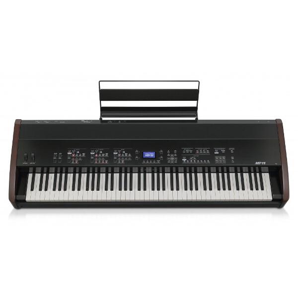 Сценическое пианино Kawai MP-11 (Цвет черный/механизм GF/Дерев. клавиши/3 педали)Цифровое пианино Kawai MP11 изготовлено с использованием технологии Grand Feel , которая вобрала в себя все качества, приобретенные за 85 лет производства акустических пианино, в результате чего игра на клавишах из качественной древесины будет ощущаться как никогда реалистично. Клавиатура MP11 состоит из 88 черных и белых клавиш, которые установлены на центральный балансировочный стержень, что обеспечивает ощущение плавного и гладкого нажатия. Клавиши, изготовленные по технологии Grand Feel, несколько длиннее, чем клавиши любого другого цифрового пианино, а расстояние до балансировочного стержня увеличено до полного соответствия роялям Kawai. При нажатии на клавишу, задняя ее часть поднимается, активируя молоточек, который и играет соответствующую ноту. Вес каждого молоточка рассчитан в соответствии с размером и весом молоточков настоящего акустического пианино. При этом низкие клавиши оснащены специальными грузами с обратной стороны, чтобы облегчить нажатие клавиш при динамичной игре.<br><br>Каждая клавиша клавиатуры, изготовленной по технологии Grand Feel, оснащена 3-сенсорной системой, которая способна реалистично отыграть любое нажатие на клавишу, даже самое мягкое. Также каждая из клавиш имеет фирменное покрытие Kawai из слоновой кости. Это покрытие поглощает влагу и облегчает процесс игры на пианино, так как оно очень гладкое и в то же время совершенно не скользкое.<br><br>Вес кг: 33.00000000
