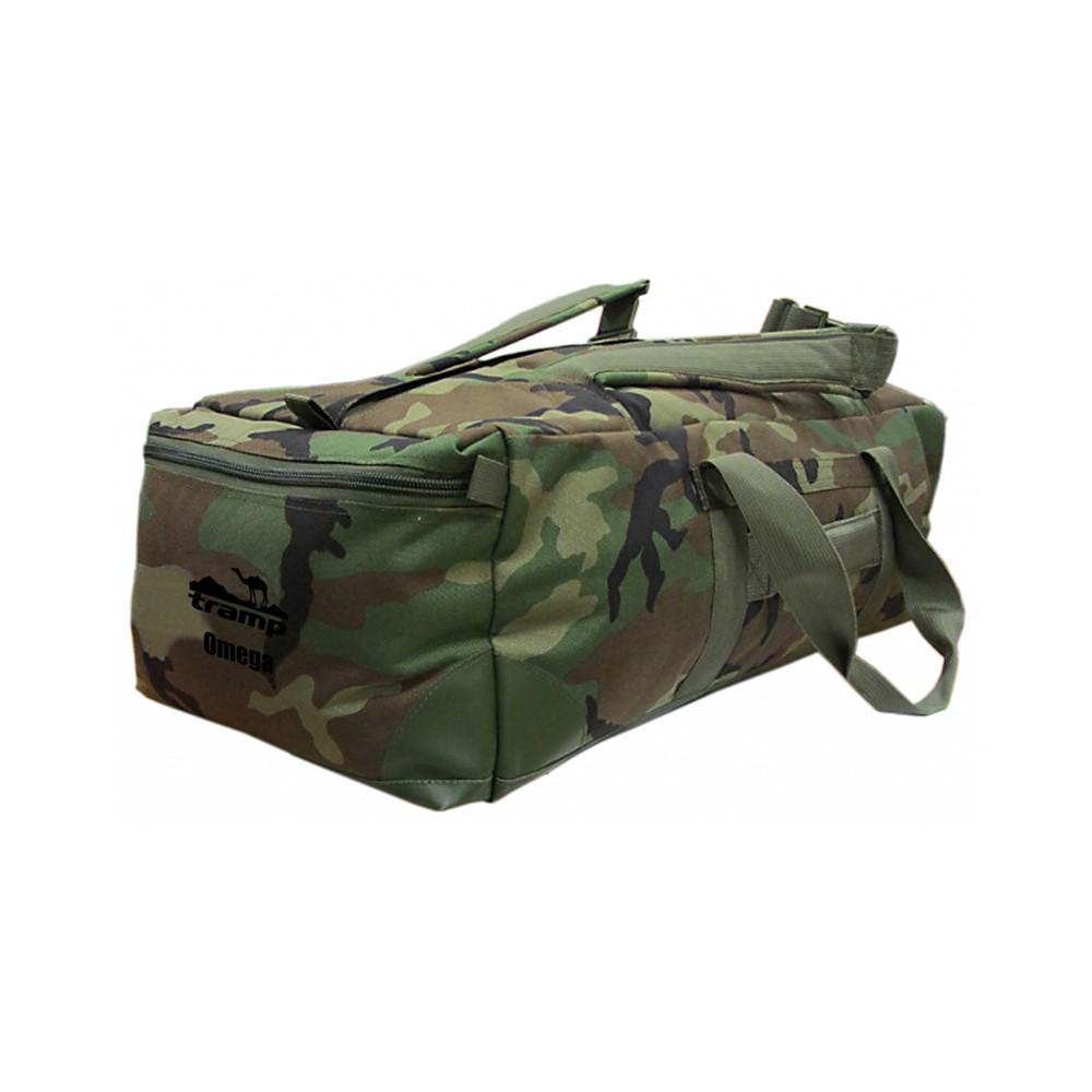 Сумка-рюкзак Tramp Omega камоУдобная сумка-рюкзак Tramp Omega с непромокаемым дном из тентовой ткани «Теза». Углы усилены. Сумка имеет два торцевых объемных кармана на «молнии» и плоский боковой карман. Доступ в основной объем сумки осуществляется через одинарную застежку «молния» на верхней части сумки. На внутренних торцевых стенках расположены плоские карманы с клапанами. На верхней части сумки расположены лямки, что позволяет использовать сумку как рюкзак. В некоторых случеях это очень удобно. Максимальная грузоподъемность данной модели – 40 кг<br>